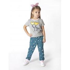 Изумрудные спортивные брюки с герберами на шнурке и манжетами для девочки